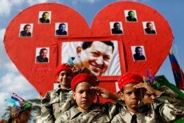 Children dressed as late Venezuelan President Hugo Chavez salute during the Carnival festival in Caracas, March 4, 2014.