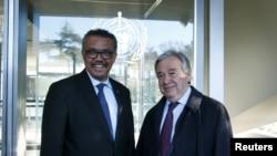 FILE - Director General of the World Health Organization (WHO) Tedros Adhanom Ghebreyesus, left, welcomes U.N. Secretary General Antonio Guterres at WHO headquarters in Geneva, Switzerland, Feb. 24, 2020.
