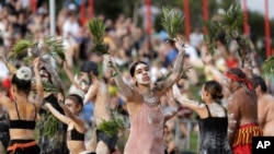 FILE - An Aboriginal dance troupe performs at Australia Day celebrations in Sydney, Australia, Jan. 26, 2020. Rap music has been employed as part of a new awareness campaign to educate Australia's Indigenous about the coronavirus.