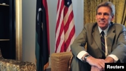 FILE - Ambassador Christopher Stevens is pictured at his residence in Tripoli, Libya, June 28, 2012.