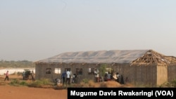 South Sudanese bustle about outside the 14-square-meter structure that has been covered with plastic sheeting and turned into a place of worship in the U.N. House IDP camp in Juba, in the days before Christmas 2014.