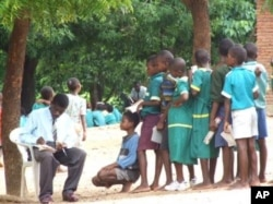 Primary school teacher marks students' work in Malawi's southern district of Phlombe.