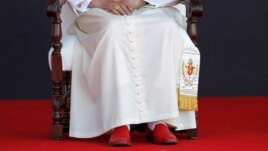 "Upon retiring Pope Benedict XVI will lay aside the red ""shoes of the fisherman"" that have been part of his papal attire, Guanajuato airport, Silao, March 26, 2012."