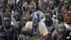 Victims of ethnic violence in Jonglei state, South Sudan, wait in line at the World Food Program distribution center in Pibor to receive emergency food rations, January 12, 2012.