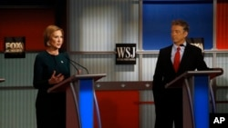 FILE - Carly Fiorina speaks as Rand Paul listens during the Republican presidential debate at the Milwaukee Theatre, Nov. 11, 2015, in Milwaukee, Wisconsin.