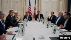 U.S. Secretary of Energy Ernest Moniz, U.S. Secretary of State John Kerry and U.S. Under Secretary for Political Affairs Wendy Sherman (L-3rd L) meet with Iranian Foreign Minister Mohammad Javad Zarif (2nd R) at a hotel in Vienna, Austria, June 28, 2015.