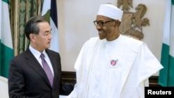 资料照片:尼日利亚总统布哈里与到访的中国外长王毅会谈(2017年1月11日)