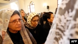 FILE - Assyrian Christians, who had fled the unrest in Syria, attend a mass at the Saint Georges Assyrian Church in Jdeideh, northeast of the Lebanese capital Beirut.