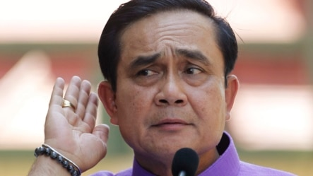 Thailand's Prime Minister Prayuth Chan-ocha listens to a question from a reporter during a press conference at the government house in Bangkok, Thailand, Tuesday, March 31, 2015.