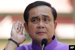 FILE - Thailand's Prime Minister Prayuth Chan-ocha listens to a question from a reporter during a press conference at the government house in Bangkok, Thailand, March 31, 2015.