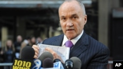Police Commissioner Ray Kelly uses a sketch drawing to show where part of a planes landing gear was found, Friday, April 26, 2013, in New York.