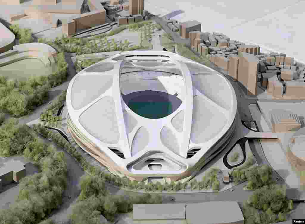 FILE - A rendering model of the new National Stadium for 2020 Tokyo Olympics and Paralympics, designed by Iraqi-British architect Zaha Hadid, is displayed at a meeting of members of the advisory council on the construction of the new stadium, in Tokyo, in this photo released by Kyodo, July 17, 2015.