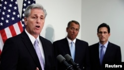 FILE - House Majority Whip Kevin McCarthy speaks as House Speaker John Boehner (C) and current Majority Leader Eric Cantor look on during a news conference on Capitol Hill in Washington.