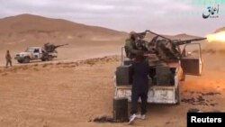 A still image taken from a video released by Islamic State-affiliated Amaq news agency Dec. 10, 2016, purports to show Islamic State fighters advancing over the Hayan mountain south of Palmyra, Syria.