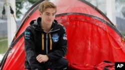 FILE - Parker Liautaud, 19, from the U.S., poses for a photo outside of a tent, during a publicity photo shoot for the launch of the Willis Resilience Expedition, in London, Sept. 30, 2013.