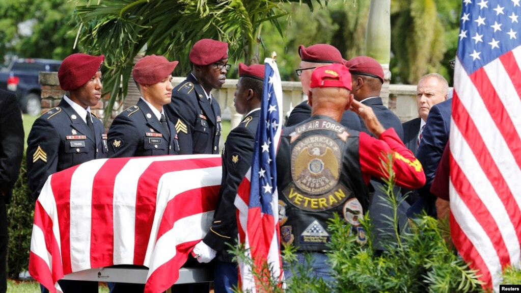 FILE - An honor guard carries the coffin of U.S. Army Sergeant La David Johnson, who was among four special forces soldiers killed in Niger, at a graveside service in Hollywood, Florida, Oct. 21, 2017.