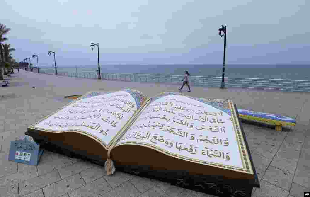 A large representation of the Quran, Islam's holy book, is displayed on the Mediterranean seafront promenade, during the Islamic holy month of Ramadan, in Beirut, Lebanon.