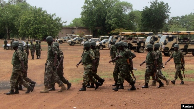 Soldiers from Lagos, part of an expected 1,000 reinforcements sent to Adamawa state to fight Boko Haram Islamists, walk near trucks as they arrive with the 23rd Armoured Brigade in Yola, Nigeria, May 20, 2013.