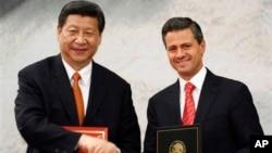 2013年6月4日中国国家主席习近平(左)和墨西哥总统恩里克·佩洛在墨西哥城会晤