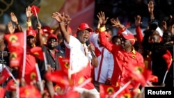 FILE - Kenya's President Uhuru Kenyatta addresses supporters during the last Jubilee Party campaign rally ahead of the August 8th election in Nakuru, Kenya, Aug. 5, 2017.