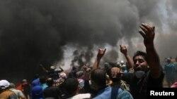 បាតុករប៉ាឡេស្ទីនធ្វើបាតុកម្មប្រឆាំងនឹងការដូរស្ថានទូតអាមេរិកទៅក្រុង Jerusalem នៅមុនថ្ងៃបុណ្យខួប Nakba លើកទី៧០ នៅតំបន់ Gaza កាលពីថ្ងៃទី១៤ ខែឧសភា ឆ្នាំ២០១៨។