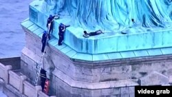 Statue of Liberty protester, New York, July 4, 2018