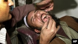 Doctor Abdul Salam, a dentist, checks a cavity of villager Gul Mohammad at his clinic in Kabul, Afghanistan, Saturday Dec.14, 2002. People living in villages often come to the city for medical check ups, as there are no doctors in the villages. (AP Photo/