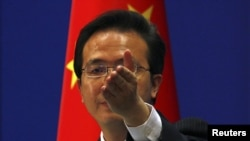 China's Foreign Ministry spokesman Hong Lei asks journalists for questions during a news conference in Beijing, July 7, 2011.