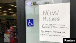 A handwritten hiring sign is posted outside a local drugstore in Solana Beach, California, U.S., July 17, 2017.
