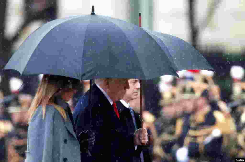 Президент США Дональд Трамп и первая леди Мелания на церемонии поминовения