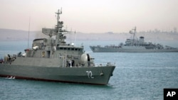 In this picture taken on April 7, 2015 and released by the semi-official Fars News Agency, Iranian warship Alborz (foreground) prepares to leave Iranian waters.