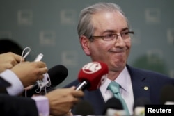 FILE- President of Brazil's Chamber of Deputies Eduardo Cunha speaks during a news conference at the Chamber of Deputies in Brasilia, Dec. 7, 2015.