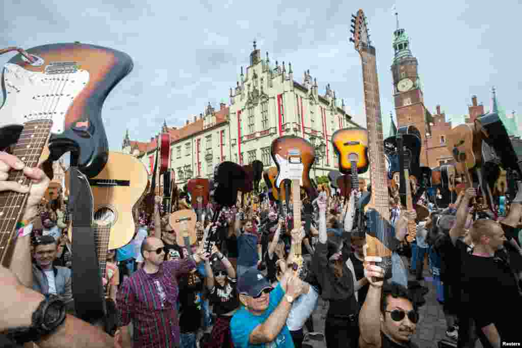 "More than 7411 guitarists play ""Hey Joe"" by Jimi Hendrix to beat the Guitar Guinness World Record at the Market Square in Wroclaw, Poland, May 1, 2018."