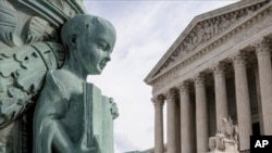 "A cherub holding an open book adorns a flagpole on the plaza of the Supreme Court in Washington, Monday, April 4, 2016. The justices ruled in a case involving the constitutional principle of ""one person, one vote"" and unanimously upheld a Texas law that counts everyone, not just eligible voters, in deciding how to draw districts. (Associated Press)"