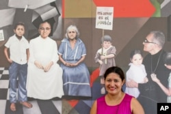Cecilia Flores poses for a portrait in front of a mural with images of Archbishop Oscar Arnulfo Romero, at the chapel where he was assassinated in 1980, in San Salvador, El Salvador, Oct. 5, 2018.