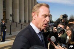 FILE - Acting Defense Secretary Patrick Shanahan speaks with reporters at the Pentagon, Jan. 28, 2019, in Washington.