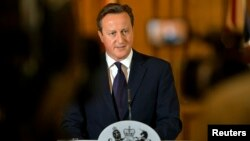 Britain's Prime Minister David Cameron makes a statement to the media following the killing of British aid worker David Haines, at Number 10 Downing Street in London September 14, 2014.