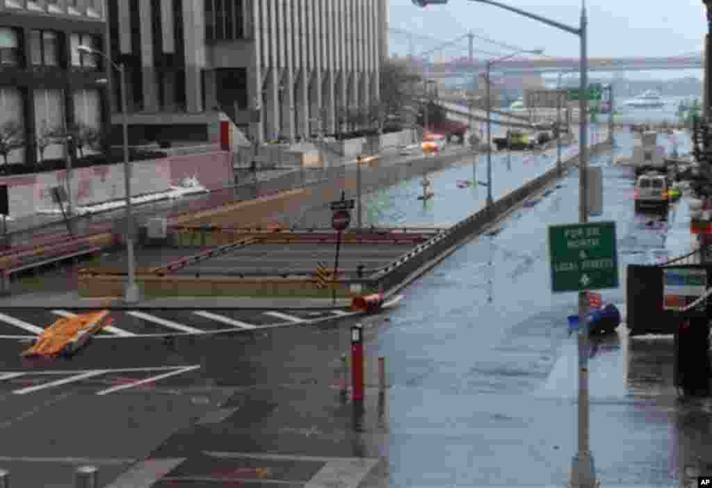 Water reaches the street level of the flooded Brooklyn Battery Tunnel, Tuesday, Oct. 30, 2012, in New York. Superstorm Sandy arrived along the East Coast putting more than 7.5 million homes and businesses in the dark and causing a number of deaths.
