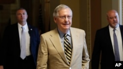FILE - Senate Majority Leader Mitch McConnell of Kentucky walks from his office on Capitol Hill in Washington, June 26, 2017.
