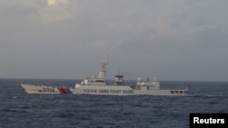 A Chinese Coast Guard ship sails in the East China Sea near the disputed isles known as Senkaku isles in Japan and Diaoyu islands in China in this picture taken and released by Japan's Coast Guard.