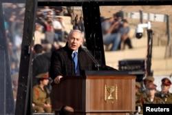 Israeli Prime Minister Benjamin Netanyahu speaks at the Israeli Air Force pilots' graduation ceremony at Hatzerim air base in southern Israel, Dec. 26, 2018.