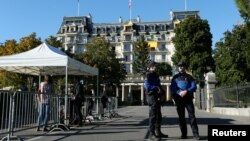 Lausanne police officers stand guard outside the Beau-Rivage Palace ahead of Syria talks in Lausanne, Switzerland, Oct. 15, 2016. After the suspension of U.S.-Russian bilateral talks, the effort took on a multilateral format.