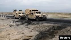 阿富汗政府軍在聯軍空軍基地附近巡邏。(2019年4月9日)