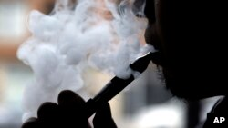 "FILE - ""Vape,"" according to the Oxford Dictionaries, is the verb that describes inhaling and exhaling the vapor from an electronic cigarette. It can also be a noun referring to the action or the device."