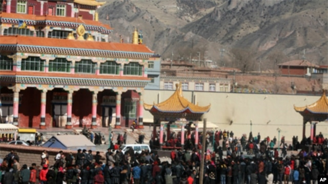 Tibetans gather at Nangchen county center grounds Wednesday for an all-day pray-in.