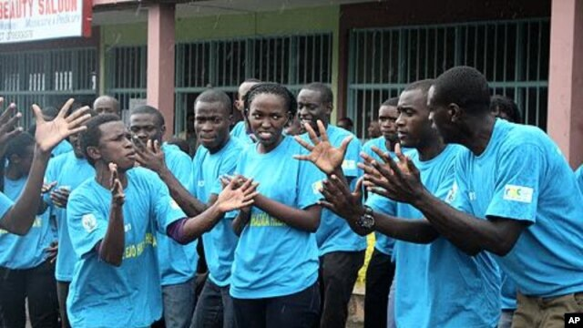 On World AIDS Day in Rwanda, teenagers in the capital rally against the spread of HIV/AIDs at an event organized by the government, Kigali, December 1, 2011.