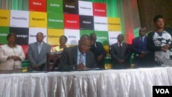 Welshman Ncube of the MDC signing a peace deal in Harare.