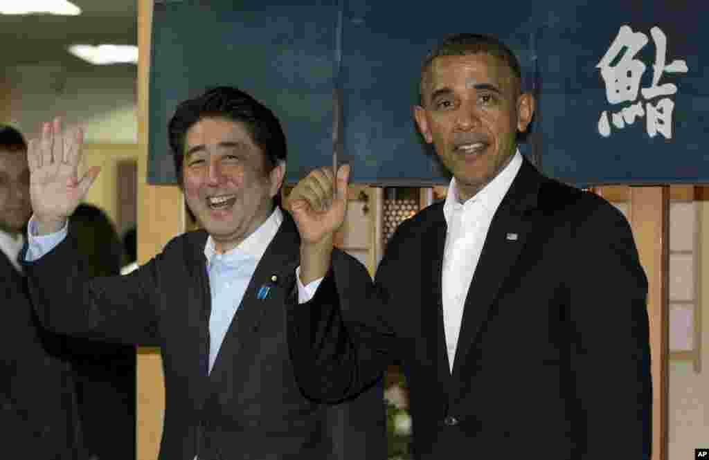 President Barack Obama and Japanese Prime Minister Shinzo Abe depart the Sukiyabashi Jiro sushi restaurant in Tokyo, April 23, 2014.