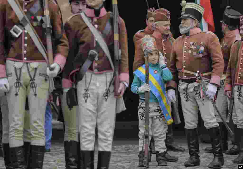 Ethnic Hungarians wearing Hussar uniforms take part in a parade in Targu Secuiesc, Romania.