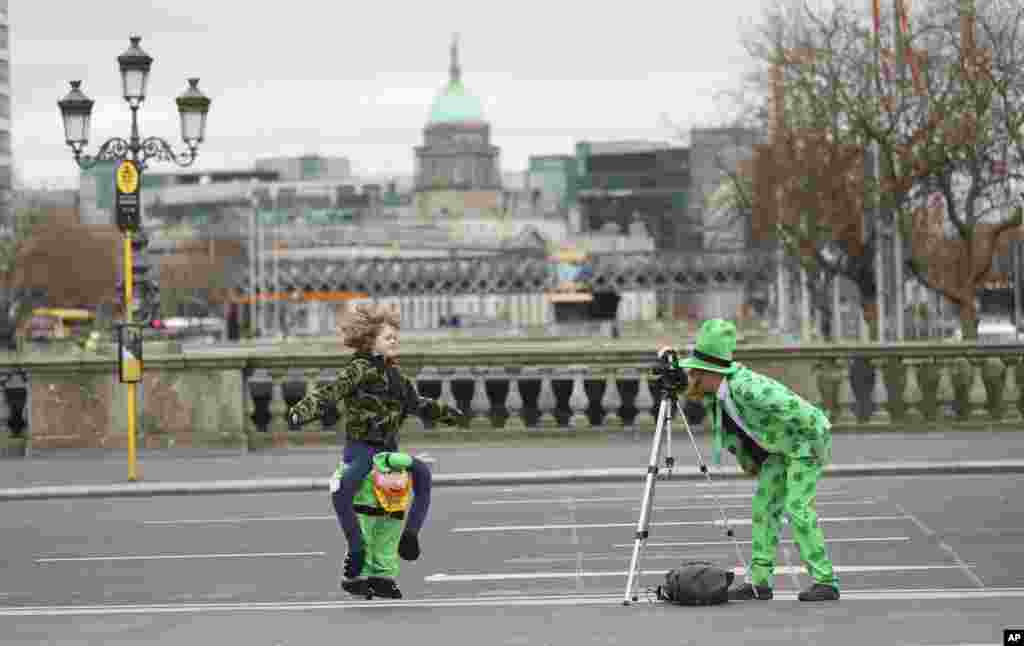 People dressed up for St. Patricks Day take a picture in Dublin, Ireland. The St Patrick's Day parades across Ireland were cancelled due to the outbreak of COVID-19.